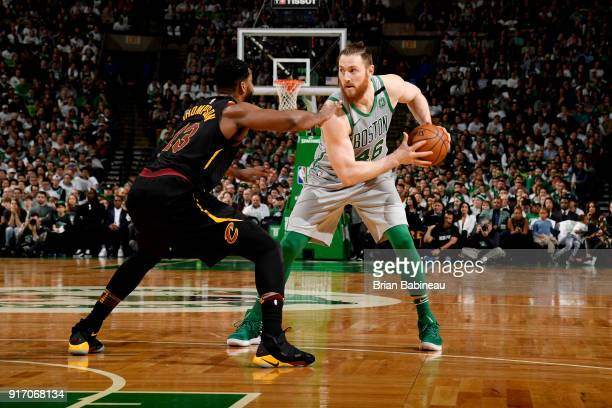 Aron Baynes of the Boston Celtics handles the ball against Tristan Thompson of the Cleveland Cavaliers during the game between the two teams on...