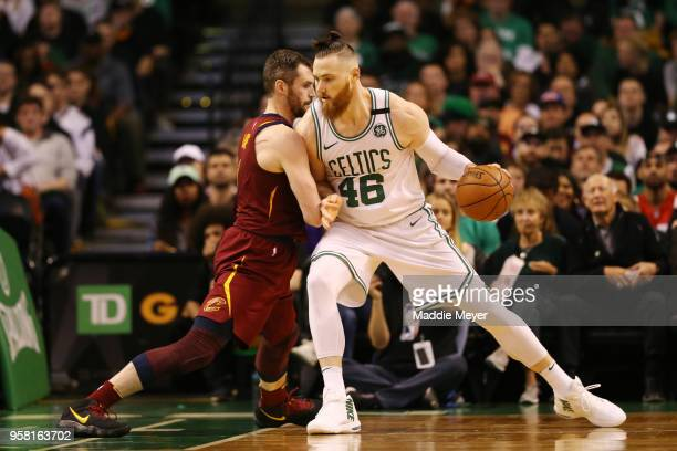 Aron Baynes of the Boston Celtics is defended by Kevin Love of the Cleveland Cavaliers during the second quarter in Game One of the Eastern...