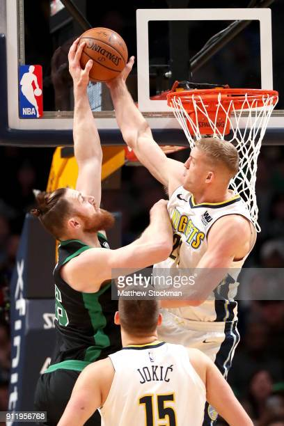 Aron Baynes of the Boston Celtics is rejected going to the basket by Mason Plumlee of the Denver Nuggets at the Pepsi Center on January 29, 2018 in...