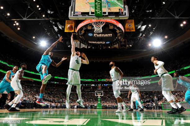 Aron Baynes of the Boston Celtics jumps to block the shot from Dwight Howard of the Charlotte Hornets on November 10 2017 at the TD Garden in Boston...