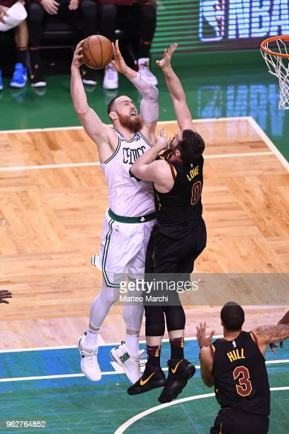 Aron Baynes of the Boston Celtics lays up a shot against Kevin Love of the Cleveland Cavaliers during Game Five of the 2018 NBA Eastern Conference...