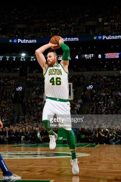 Aron Baynes of the Boston Celtics looks to pass against the New York Knicks on November 21 2018 at TD Garden in Boston Massachusetts NOTE TO USER...