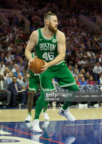 Aron Baynes of the Boston Celtics reaches for the ball against the Philadelphia 76ers at the Wells Fargo Center on October 20 2017 in Philadelphia...