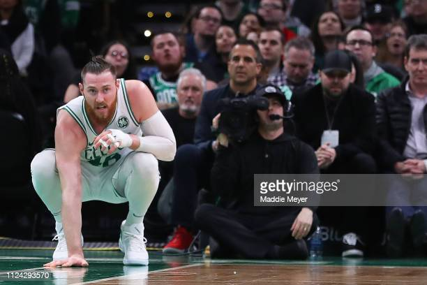 Aron Baynes of the Boston Celtics reacts to an injury in the first quarter during a game against the Cleveland Cavaliers at TD Garden on January 23...
