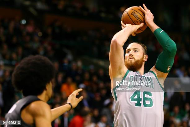 Aron Baynes of the Boston Celtics shoot the ball during a game against the Brooklyn Nets at TD Garden on April 11 2018 in Boston Massachusetts NOTE...