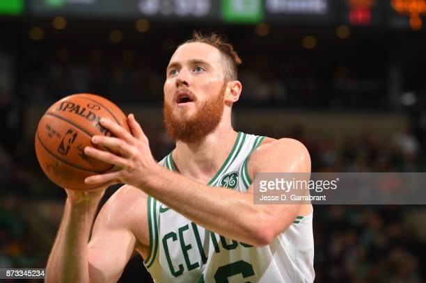 Aron Baynes of the Boston Celtics shoots a foul shot during the game against the Toronto Raptors on November 12 2017 at the TD Garden in Boston...