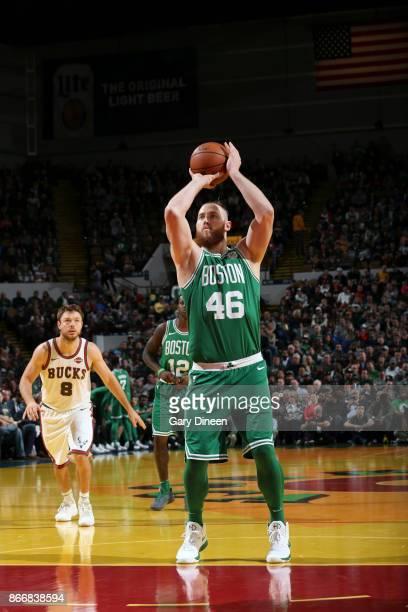 Aron Baynes of the Boston Celtics shoots the ball against the Milwaukee Bucks on October 26 2017 at the UWMilwaukee Panther Arena in Milwaukee...
