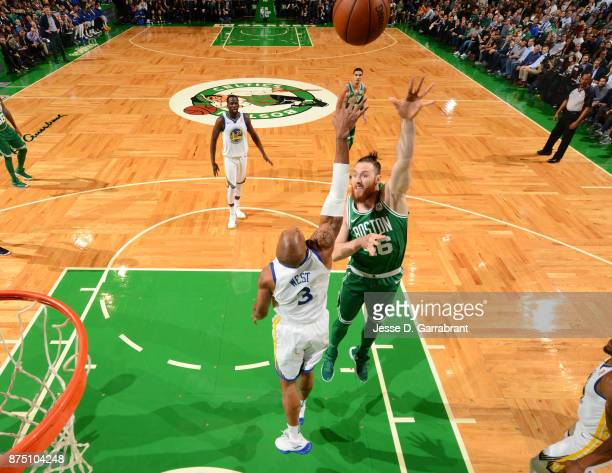Aron Baynes of the Boston Celtics shoots the ball during the game against the Golden State Warriors on November 16 2017 at the TD Garden in Boston...