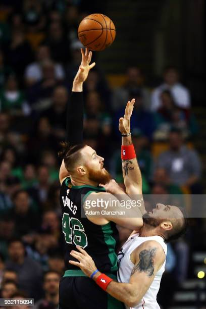Aron Baynes of the Boston Celtics shoots the ball over Marcin Gortat of the Washington Wizards in the first quarter of a game at TD Garden on March...