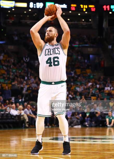 Aron Baynes of the Boston Celtics takes a shot against the Charlotte Hornets during the second half at TD Garden on October 2 2017 in Boston...