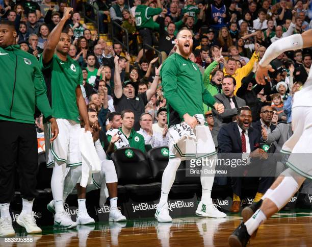 Aron Baynes of the Boston Celtics with his teammates react to a play against the Philadelphia 76ers on November 30 2017 at the TD Garden in Boston...