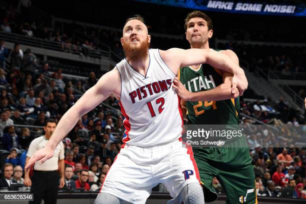 Aron Baynes of the Detroit Pistons boxes out against Jeff Withey of the Utah Jazz during the game on March 15 2017 at The Palace of Auburn Hills in...