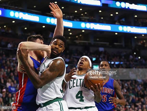 Aron Baynes of the Detroit Pistons defends Amir Johnson of the Boston Celtics as Isaiah Thomas of the Boston Celtics drives towards the basket during...