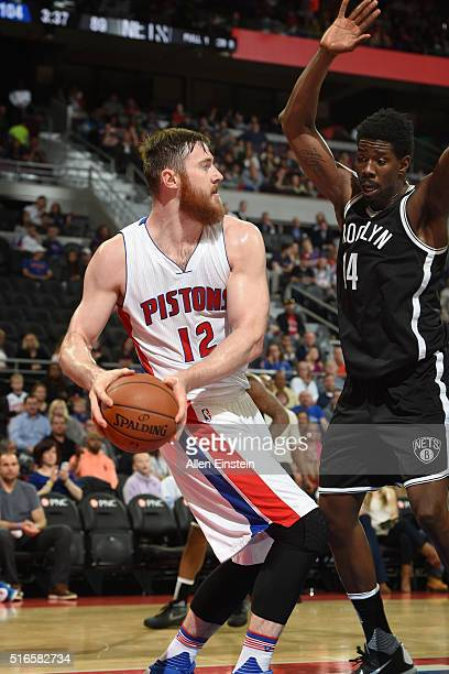 Aron Baynes of the Detroit Pistons defends the ball against the Brooklyn Nets during the game on March 19 2016 at The Palace of Auburn Hills in...