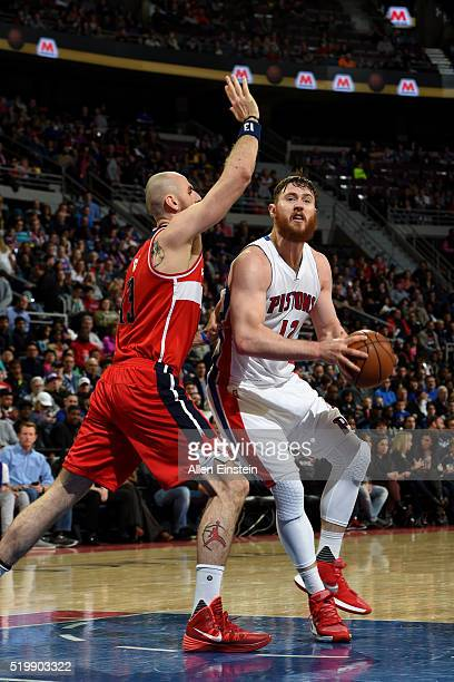 Aron Baynes of the Detroit Pistons drives to the basket against Marcin Gortat of the Washington Wizards on April 8 2016 at The Palace of Auburn Hills...