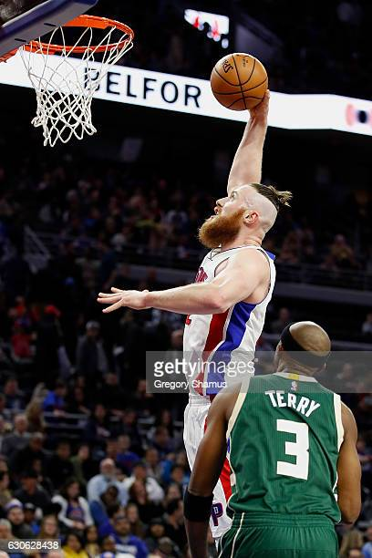 Aron Baynes of the Detroit Pistons gets off a second half shot next to Jason Terry of the Milwaukee Bucks at the Palace of Auburn Hills on December...