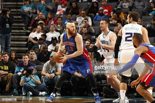 Aron Baynes of the Detroit Pistons handles the ball against the Charlotte Hornets on December 7 2016 at Spectrum Center in Charlotte North Carolina...
