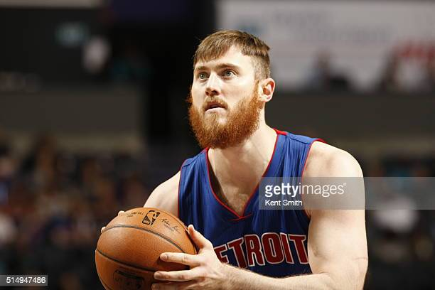 Aron Baynes of the Detroit Pistons shoots a free throw against the Charlotte Hornets during the game at the Time Warner Cable Arena on March 11 2016...