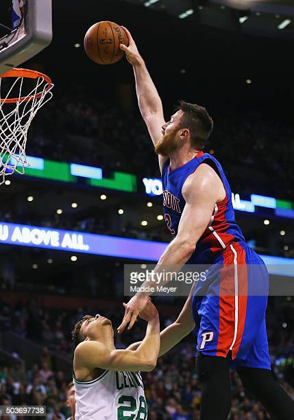 Aron Baynes of the Detroit Pistons takes a shot over RJ Hunter of the Boston Celtics during the second quarter at TD Garden on January 6 2016 in...