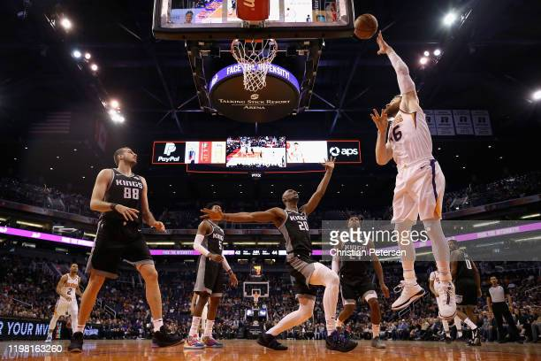 Aron Baynes of the Phoenix Suns attempts a shot over Harry Giles III of the Sacramento Kings during the first half the NBA game at Talking Stick...