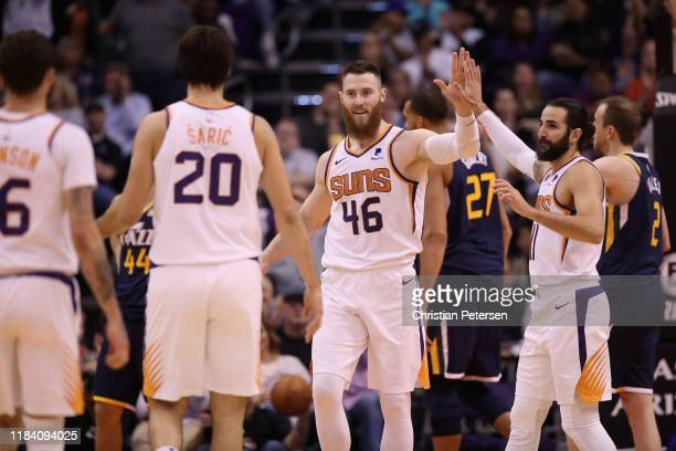 Aron Baynes of the Phoenix Suns high fives Ricky Rubio after scoring against the Utah Jazz during the second half of the NBA game at Talking Stick...