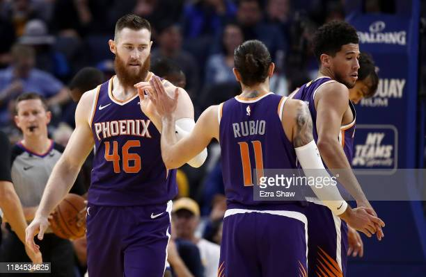 Aron Baynes of the Phoenix Suns is congratulated by Ricky Rubio after he made a basket against the Golden State Warriors at Chase Center on October...