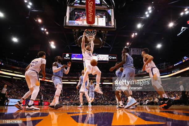 Aron Baynes of the Phoenix Suns slam dunks the ball against the Memphis Grizzlies during the second half of the NBA game at Talking Stick Resort...
