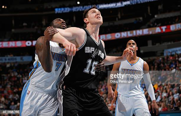Aron Baynes of the San Antonio Spurs battles for position against JJ Hickson of the Denver Nuggets at Pepsi Center on January 20 2015 in Denver...