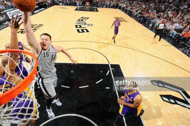Aron Baynes of the San Antonio Spurs dunks against the Los Angeles Lakers at the ATT Center on March 14 2014 in San Antonio Texas NOTE TO USER User...