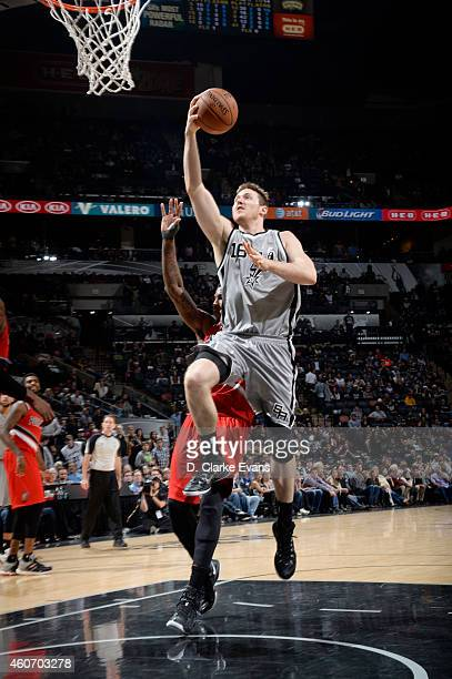 Aron Baynes of the San Antonio Spurs goes for the layup against the Portland Trail Blazers during the game on December 19 2014 at ATT Center in San...