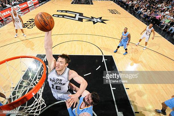 Aron Baynes of the San Antonio Spurs goes to the basket against the Denver Nuggets on April 3 2015 at the ATT Center in San Antonio Texas NOTE TO...