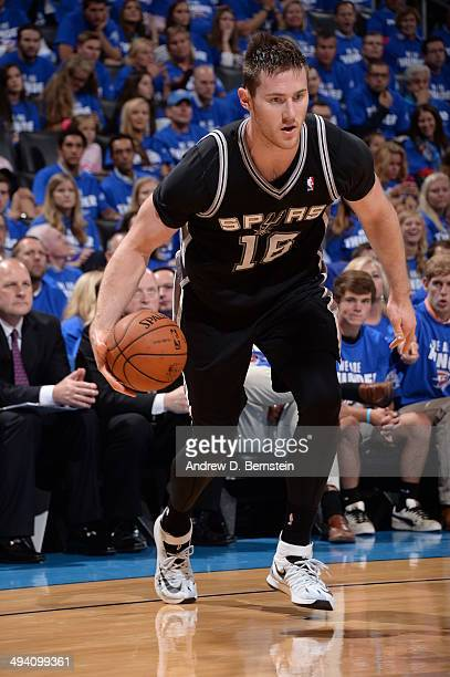 Aron Baynes of the San Antonio Spurs handles the ball against the Oklahoma City Thunder in Game Four of the Western Conference Finals during the 2014...