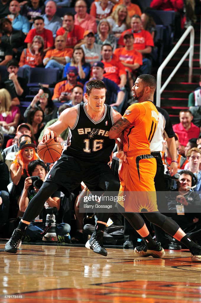 Aron Baynes #16 of the San Antonio Spurs posts up against the Phoenix Suns on February 21, 2014 at U.S. Airways Center in Phoenix, Arizona.