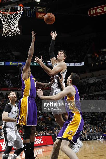 Aron Baynes of the San Antonio Spurs shoots against the Los Angeles Lakers on April 16 2014 at the ATT Center in San Antonio Texas NOTE TO USER User...