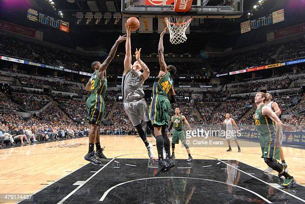 Aron Baynes of the San Antonio Spurs shoots against the Utah Jazz at the ATT Center on March 16 2014 in San Antonio Texas NOTE TO USER User expressly...