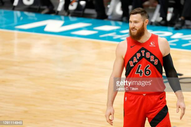 Aron Baynes of the Toronto Raptors looks on during the first half of their game against the Charlotte Hornets at Spectrum Center on December 12, 2020...