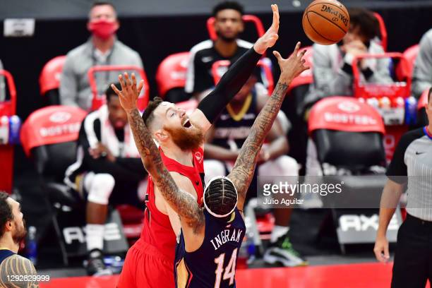 Aron Baynes of the Toronto Raptors shoots the ball against Brandon Ingram of the New Orleans Pelicans during the second half of a game at Amalie...