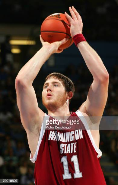 Aron Baynes of the Washington State University Cougars shoots a free throw during the second half of their NCAA Pac10 game against the UCLA Bruins on...
