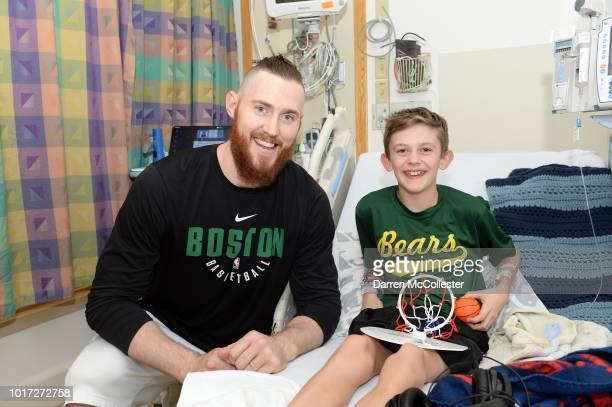Aron Baynes visits David at Boston Children's Hospital August 15 2018 in Boston Massachusetts