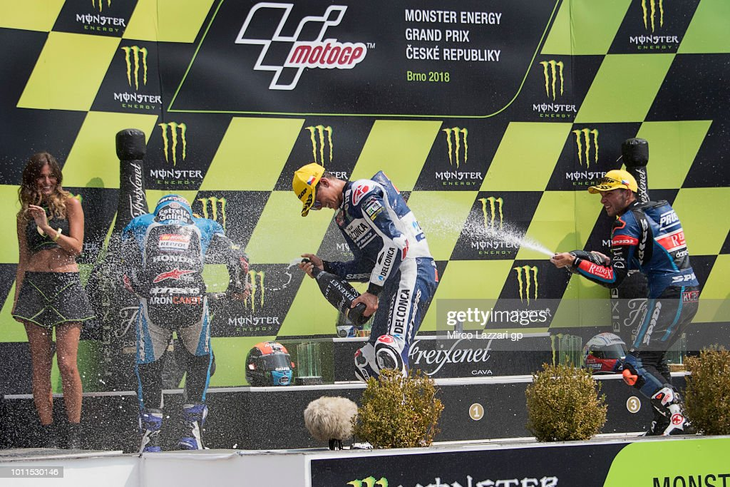 Aron Canet of Spain and Estrella Galicia 0,0, Fabio Di Giannantonio of Italy and Del Conca Gresini Moto3 and Jakub Kornfeil of Czech Republic and Pruestel GP celebrate on the podium at the end of the Moto3 Race during the MotoGp of Czech Republic - Race at Brno Circuit on August 5, 2018 in Brno, Czech Republic.