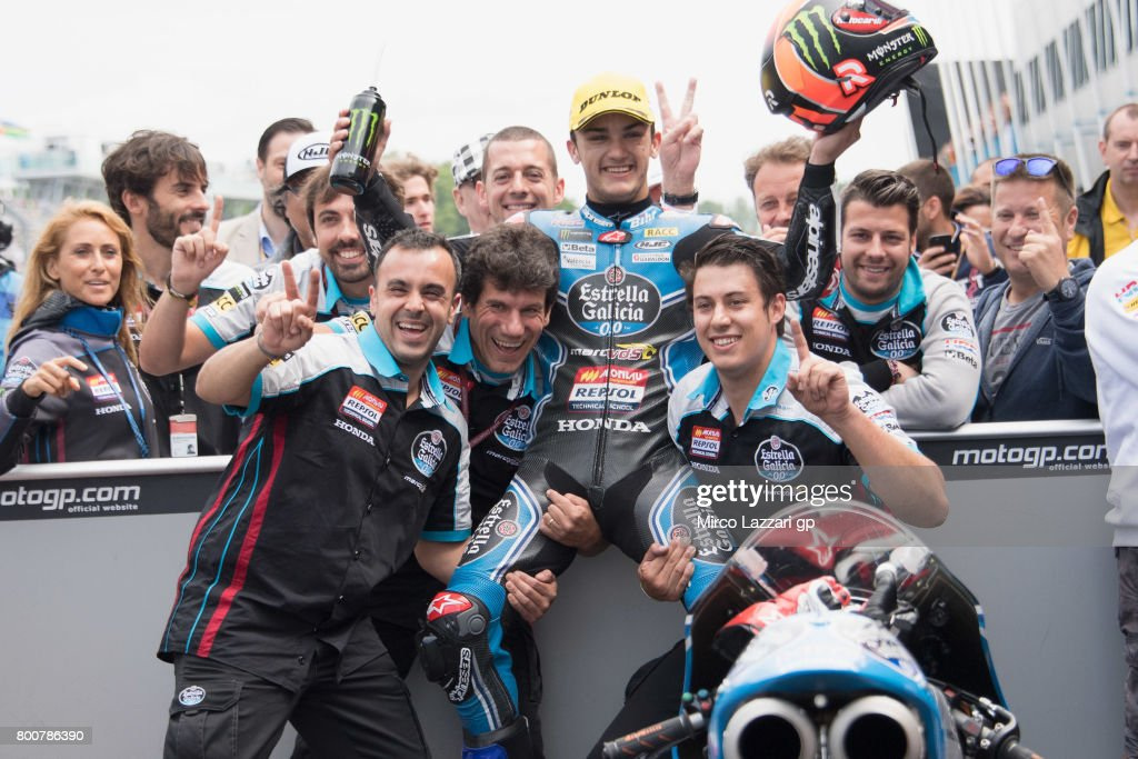 Aron Canet of Spain and Estrella Galicia 0,0 celebrates the victory with team under the podium at the end of the Moto3 Race during the MotoGP Netherlands - RaceMotoGP Netherlands - Race on June 25, 2017 in Assen, Netherlands.
