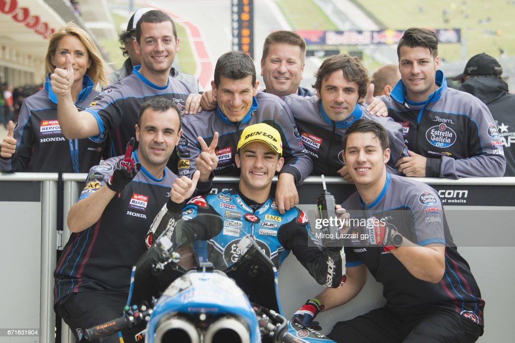 Aron Canet of Spain and Estrella Galicia 0,0 celebrates with team the Moto3 pole position at the end of the qualifying practice during the qualifying practice during the MotoGp Red Bull U.S. Grand Prix of The Americas - Qualifying at Circuit of The Americas on April 22, 2017 in Austin, Texas.