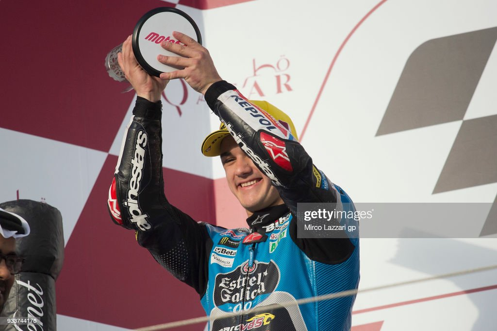 Aron Canet of Spain and Estrella Galicia 0,0 Honda celebrates the second place on the podium at the end of the Moto3 race during the MotoGP of Qatar - Race at Losail Circuit on March 18, 2018 in Doha, Qatar.