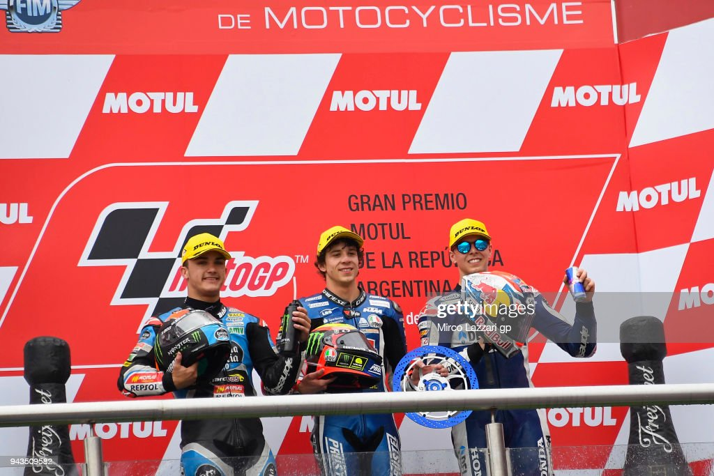 Aron Canet of Spain and Estrella Galicia 0,0 Honda, Marco Bezzecchi of Italy and Pruestel GP KTM and Fabio Di Giannantonio of Italy and Del Conca Gresini Moto3 Honda celebrates on the podium at the end of the Moto3 race during the MotoGp of Argentina - Race on April 8, 2018 in Rio Hondo, Argentina.