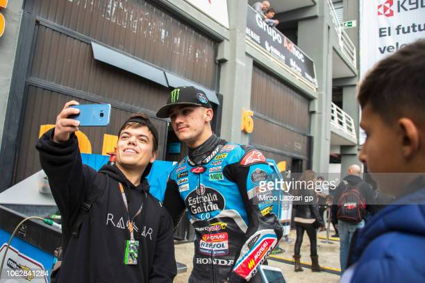 Aron Canet of Spain and Estrella Galicia 0,0 poses with fans in paddock during the MotoGP Of Valencia - Qualifying at Ricardo Tormo Circuit on...