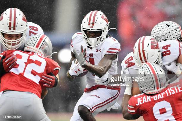 Aron Cruickshank of the Wisconsin Badgers looks for running room in the third quarter against the Ohio State Buckeyes at Ohio Stadium on October 26...