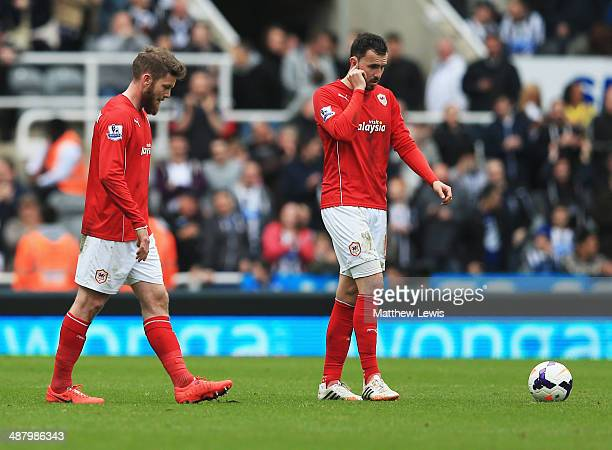 Aron Gunnarsson and Jordon Mutch of Cardiff City look dejected during the Barclays Premier League match between Newcastle United and Cardiff City at...