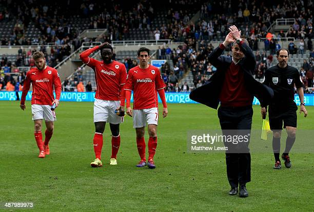 Aron Gunnarsson Kenwyne Jones and Peter Whittingham of Cardiff City look dejected as Ole Gunnar Solskjaer manager of Cardiff City applauds the...