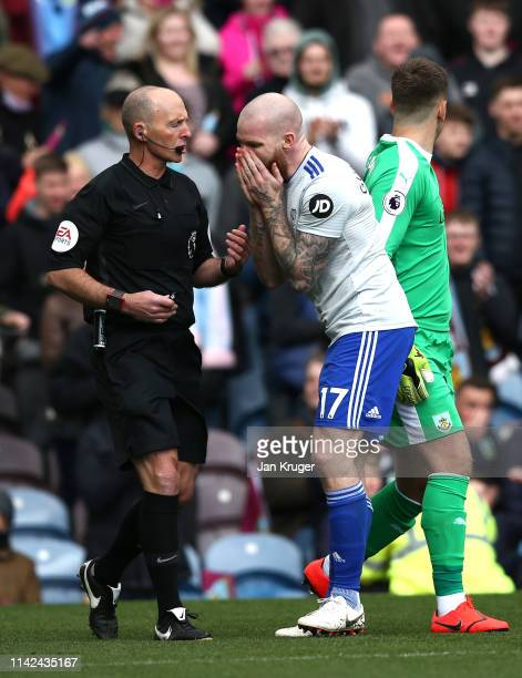 Aron Gunnarsson of Cardiff City argues with referee Mike Dean during the Premier League match between Burnley FC and Cardiff City at Turf Moor on...