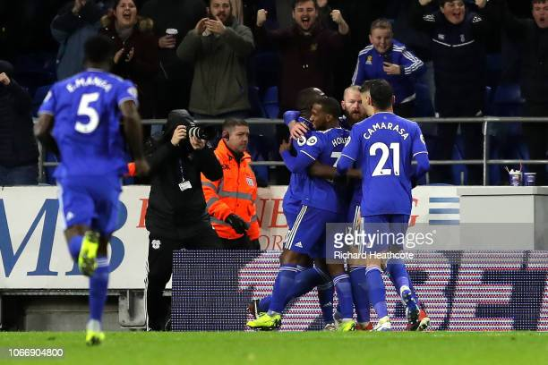 Aron Gunnarsson of Cardiff City celebrates with team mates after scoring his sides first goal during the Premier League match between Cardiff City...